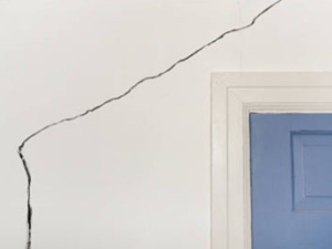 Crack in wall above door